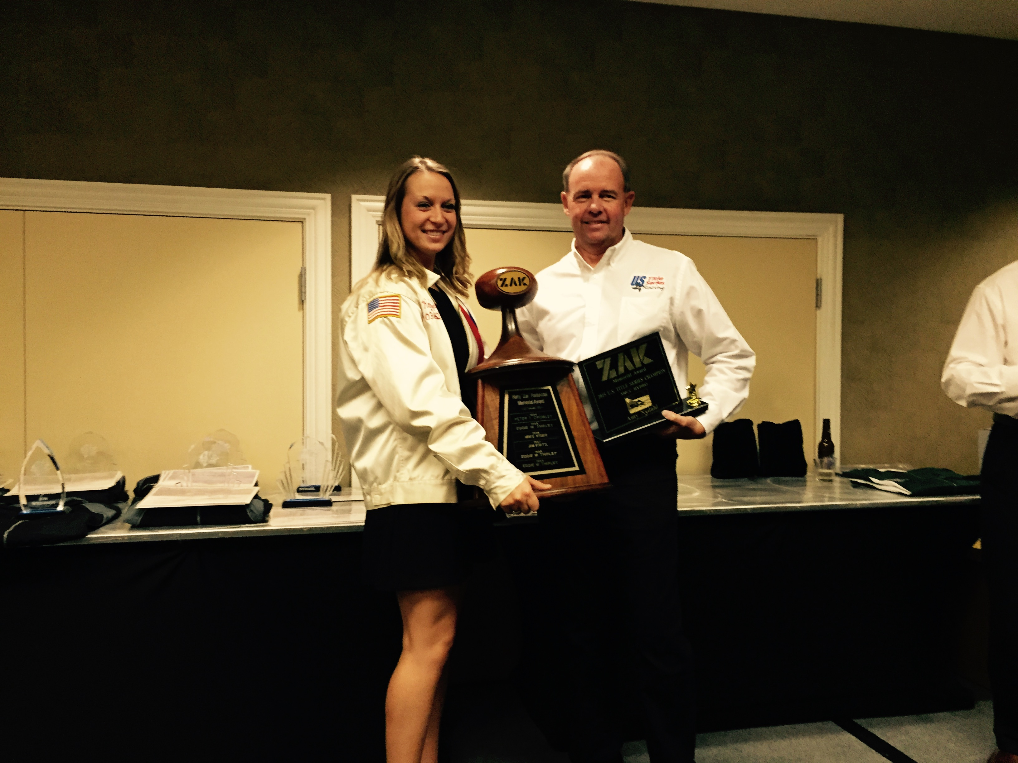 Amy accepting the Zak award from Todd Brinkman at the Title Series meeting